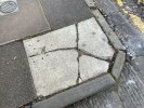 Poor pavement surface, broken & tilted slabs, broken kerbs