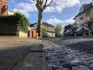 Road camber increased so much with new road surfacing now damaging underside of cars entering and exiting driveway